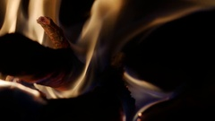 Fire smoldering in a stove Stock Footage