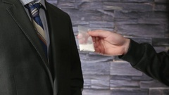 4K Inserting Cocaine in Businessman Pocket - Drug Deal Stock Footage