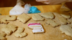Decorating Christmas stocking cakes by hand with icing sugar. Stock Footage
