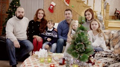 Happy families showing thumb up at camera at christmas party Stock Footage