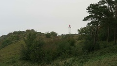 Lighthouse on Dornbusch hill in Hiddensee Isle (Germany) Stock Footage