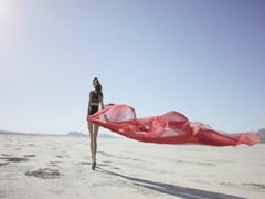 Girl with a fabric walking and dancing in the desert Stock Footage