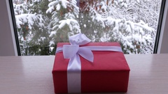 Box of gift on the table in front of the window in the winter Stock Footage