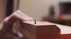 Furniture making , Wood working. Putting a screw through timber Stock Footage
