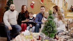 Happy family showing thumb up at christmas party Stock Footage