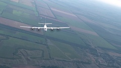 The Tu-95 in u-turn over the river Stock Footage