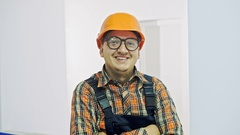 Portrait of a worker in the new office on a white background Stock Footage