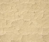 Cracked mud plaster wall closeup Stock Photos