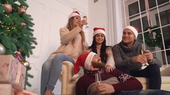 Women and men relish drink at christmas Stock Footage
