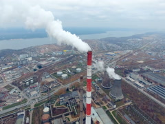 The view from the top - industrial plant pipe smoking in a industrial area Stock Footage