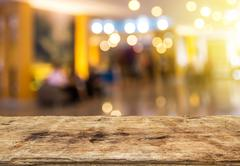 Selected focus perspective wood table and coffee shop blur background Stock Photos