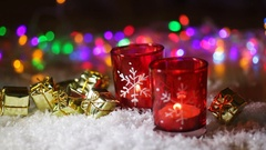 Two red candlestick and multi-colored lights in the background Stock Footage