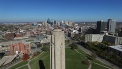 Aerial dolly around WWI museum tower showing Kansas City in background Stock Footage