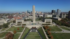 Aerial push in to WWI museum with Kansas City in background Stock Footage