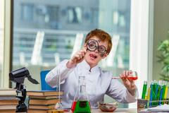 Young crazy chemist working in the lab Stock Photos
