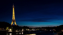 Night view over the Seine river in Paris, France, with the Eiffel Tower Stock Footage