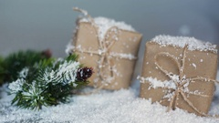 Christmas boxes for gifts and branches in the snow on a white background Stock Footage