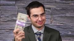 4K Rich Businessman Showing off his Cash stack and Smelling it Stock Footage
