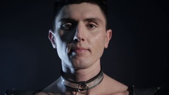 Close-up portrait of sexy man wear choker necklace and many female hands hugging Stock Footage