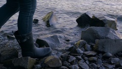 Closeup Of Woman's Feet As She Walks Along Rocky Shoreline Stock Footage