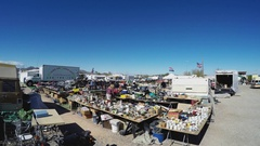 Wide Shot Of Tables With Swap Meet Goods For Sale Stock Footage