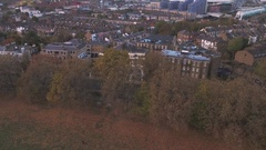Aerial approaching view of a typical Victorian village in North London Stock Footage