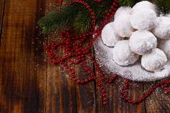 Traditional Christmas cookies with almonds on dark wooden background Stock Photos