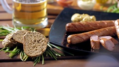 Eating a delicious meal composed by bratwurst, beer and many other ingredients Stock Footage