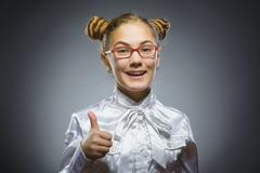 Closeup portrait successful happy girl show thumb up isolated grey background Stock Photos