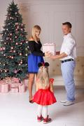 The parents give a gift to the child in the new year Kuvituskuvat