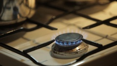 Detail shot on blue gas flame in the kitchen Stock Footage
