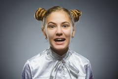 Angry girl isolated on gray background. Negative human emotion. Closeup Stock Photos