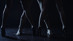Male legs and sexy female legs isolated on dark background. Woman legs go away Stock Footage