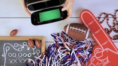 Game day football party table. Watching game on VR goggles. Stock Footage
