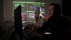 Man and woman working with computer, hacking computer system Stock Footage