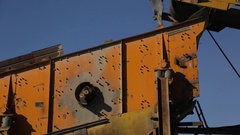 Working mechanical screening feeder with infeed conveyor belt Stock Footage
