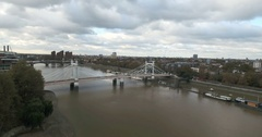 Aerial push out view of the Royal Albert bridge over the river Thames in London Stock Footage