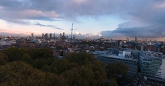 Aerial push out view of the City of London at sunset Stock Footage