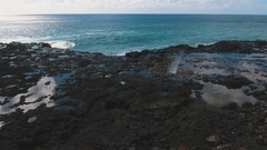 Aerial tracking shot of Spouting Horn in Kauai, Hawaii. Stock Footage