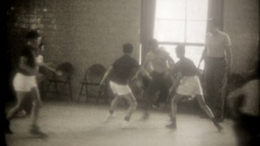 Young boys play basketball in the school gymnasium, 3791 vintage film home movie Stock Footage