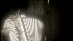 Young boy plays accordion at home for mom & dad, 3792 vintage film home movie Stock Footage