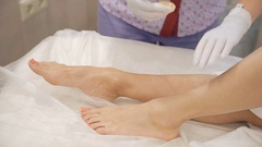 Sugar depilation in the woman's leg Stock Footage