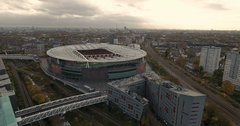 Aerial push in view of the Arsenal football stadium in North London Stock Footage
