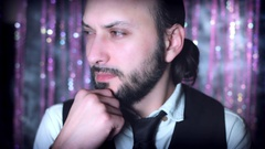 4K Disco Christmas Shot of Man Thinking and Looking at Camara Stock Footage