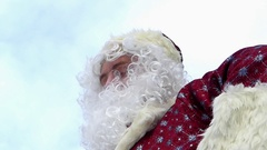 "Santa Claus makes one ""like"" from his hand and sends to you. Bottom view. Stock Footage"