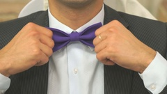 Handsome young man tightening bow tie Stock Footage