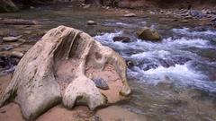 View of rock with grooves lying in river Stock Footage