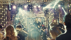 Jazz band performing on the stage in a bright stage spotlights and confetti. A Stock Footage