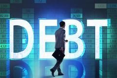 Businessman in debt business concept Kuvituskuvat