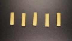 TOP VIEW: Tortiglioni pastas shake on a black table (stop motion) Stock Footage